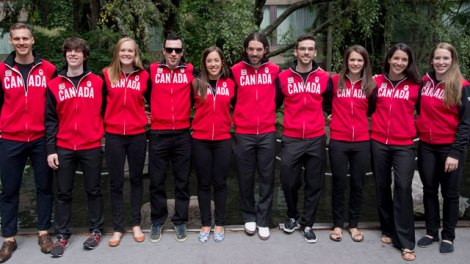 Northwest Territories resident - and newly minted Olympian - Michael Gilday stands with his Team Canada teammates, fourth from left.